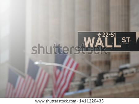 Stock market photo with waning America flag #1411220435