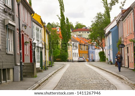 Trondheim, Norway 05/29/2019 : Bakklandet- popular torusitic district in Trondheim with colorful wooden houses and shops  #1411267946