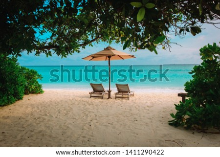Two beach chairs on tropical vacation at sea #1411290422