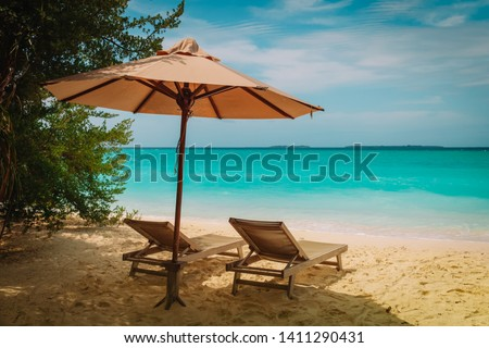 Two beach chairs on tropical vacation at sea #1411290431
