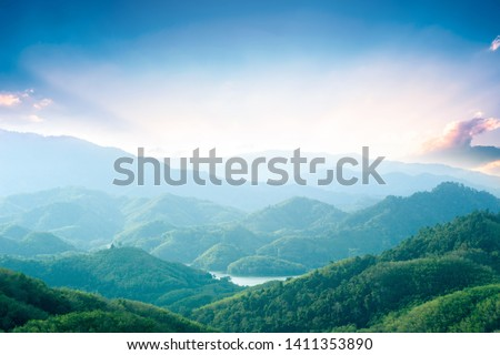 World Environment Day concept: Green mountains and beautiful sky clouds under the blue sky #1411353890