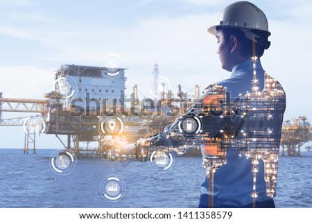 Double exposure of Engineer with oil refinery industry plant background, industrial instruments in the factory and physical system icons concept, Industry 4.0 concept image #1411358579