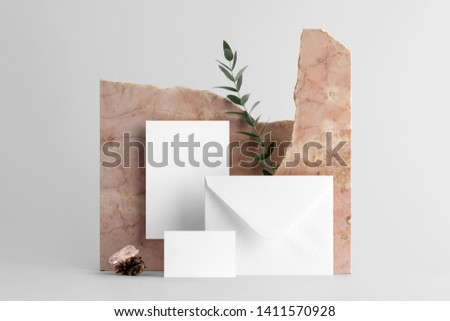 Real photo, stationery branding mockup template, isolated on light grey background, with marble and floral elements to place your design. Royalty-Free Stock Photo #1411570928