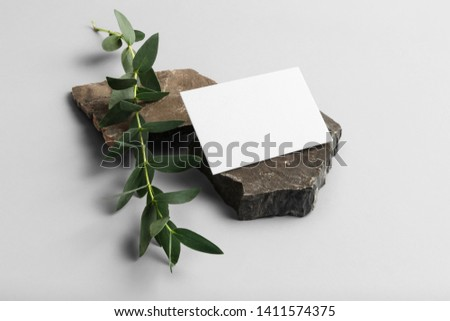 Real photo, business cards branding mockup template to place your design, isolated on light grey background, with marble, granite, gloden and floral elements.