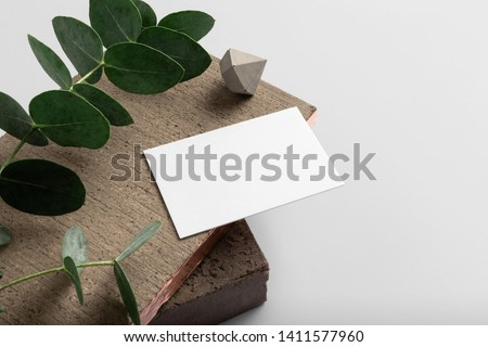 Real photo, stationery branding mockup template to place your design, isolated on light grey background, with concrete, copper, granite and floral elements. #1411577960