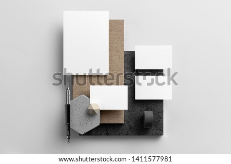 Real photo, stationery branding mockup template to place your design, isolated on light grey background, with concrete, copper, granite and floral elements. #1411577981