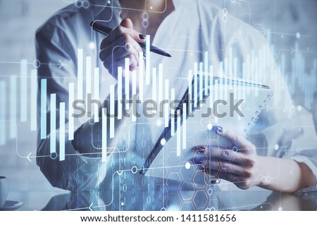 Financial chart drawn over hands taking notes background. Concept of research. Multi exposure #1411581656