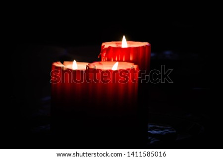 Three lit tall red candles #1411585016
