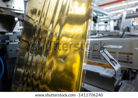 Industrial Label Printing Equipment Closeup DetailMetallic Foil Embossing Web #1411706240