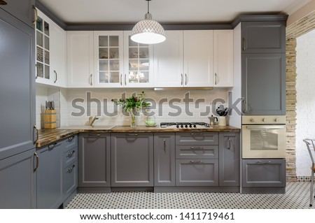 interior of modern luxury grey and white wooden kitchen Royalty-Free Stock Photo #1411719461