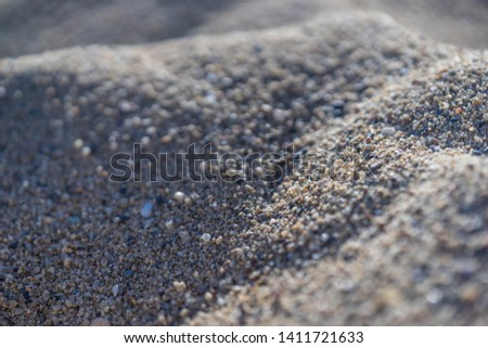 A macro picture of sand in Barcelona #1411721633