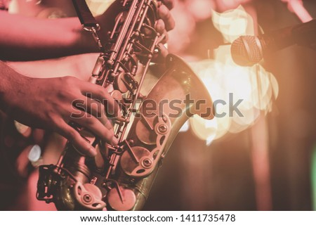 Musical instruments ,Saxophone Player hands Saxophonist playing jazz music. Alto sax musical instrument closeup  #1411735478