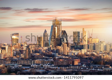The iconic skyline of the financial district City of London during sunrise, UK #1411795097