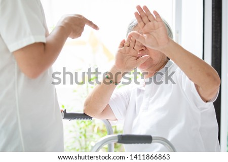 Asian elderly woman were physically abused,attacking in house,angry man raised punishment fist,stop physical abuse senior people,caregiver,family stop violence and aggression concept