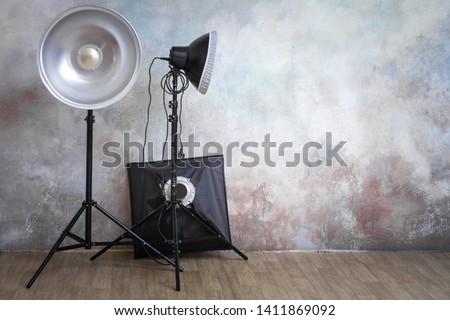 Professional lighting equipment in the photo studio on the original gray background, minimalist interior and lighting equipment #1411869092