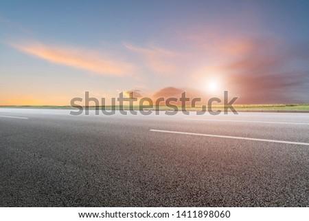 Empty Highway Asphalt Road and Beautiful Sky Landscape #1411898060