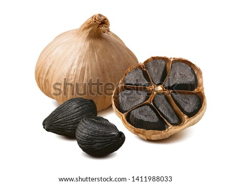 Black garlic bulbs and cloves isolated on white background. Package design composition with clipping path Royalty-Free Stock Photo #1411988033