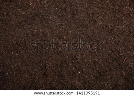 Textured fertile soil as background. Gardening season Royalty-Free Stock Photo #1411995191