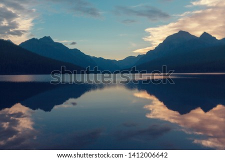 Serenity lake in the mountains Royalty-Free Stock Photo #1412006642