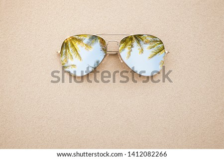 Summer concept, sunglasses in the sand, on the beach with copy space Royalty-Free Stock Photo #1412082266