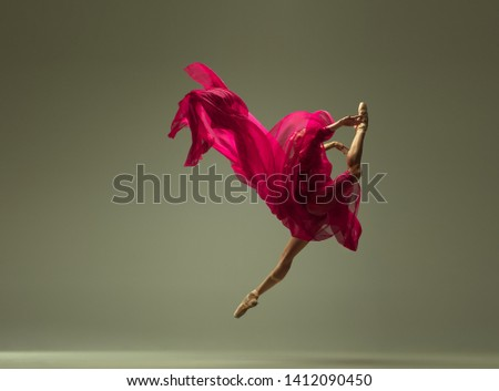 Graceful ballet dancer or classic ballerina dancing isolated on grey studio background. Woman with the pink silk cloth. The dance, grace, artist, contemporary, movement, action and motion concept. #1412090450