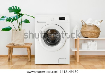 Clothes washing machine in laundry room interior #1412149130