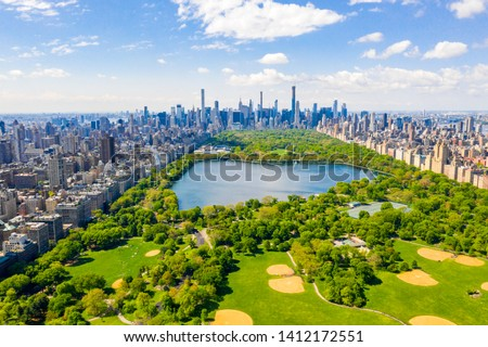 Central Park aerial view, Manhattan, New York. Park is surrounded by skyscraper. Beautiful view of the Jacqueline Kennedy Onassis Reservoir in the center of the park. #1412172551