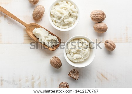 Composition with shea butter on light background #1412178767