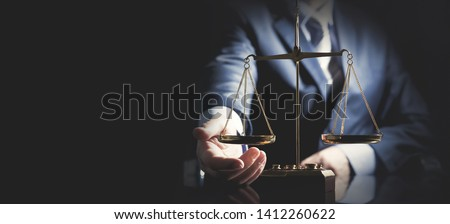 Weight scale of justice, lawyer or attorney concept. Unrecognizable person studio shot, copy space web banner background #1412260622