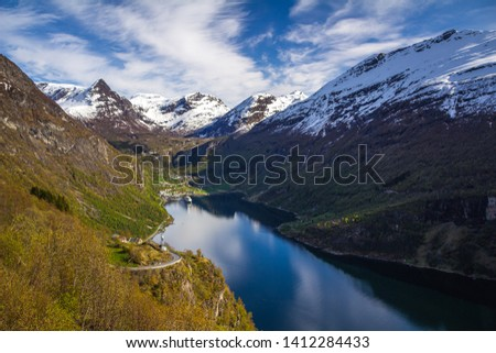 Famous Geiranger fiord in Norway. Spring time beautiful weather and colours. Geirangerfjorden fiord and high mountains Reinheimen. #1412284433