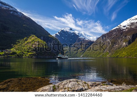 Famous Geiranger fiord in Norway. Spring time beautiful weather and colours. Geirangerfjorden fiord and high mountains Reinheimen. #1412284460