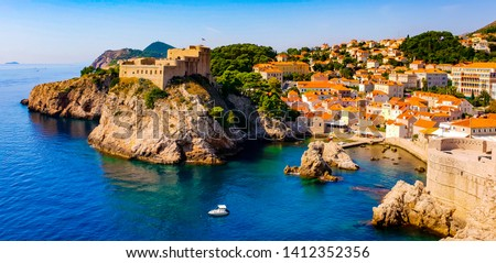 Amazing view on the Adriatic sea from the fortress walls of Dubrovnik, Croatia, with its historical old town, on a sunny summer day  #1412352356