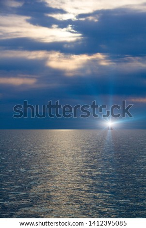 Light of a beacon in the sea