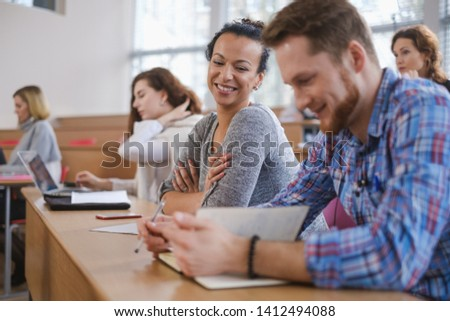 Multinational group of students in an auditorium #1412494088