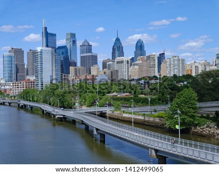 Philadelphia skyline in 2019 with recreational boardwalk along the Schuylkill River, known as the Schuylkill Banks #1412499065