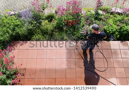 Cleaning stone slabs with the high-pressure cleaner Royalty-Free Stock Photo #1412539490