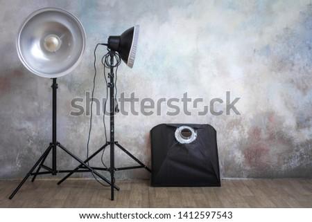 Professional lighting equipment in the photo studio on the original gray background, minimalist interior and lighting equipment #1412597543