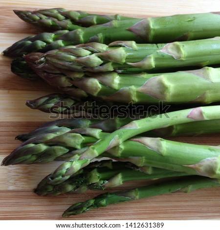 Macro Photo food vegetable asparagus. Texture background of green fresh asparagus sticks. Image of product vegetable stems of green asparagus #1412631389