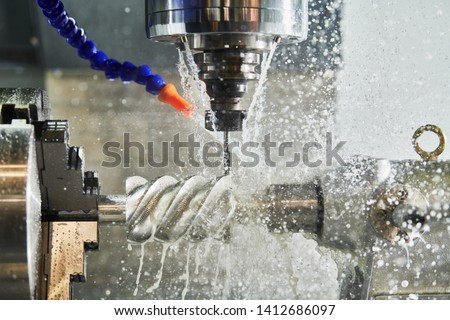 CNC milling machine work. Coolant and lubrication in gear metalwork industry #1412686097