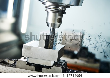 milling cnc machine at metal work industry. Multitool precision machining. Shallow depth of view on shavings #1412714054
