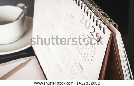 Happy new year 2020 concept: Close up calendar on desktop  Royalty-Free Stock Photo #1412832002