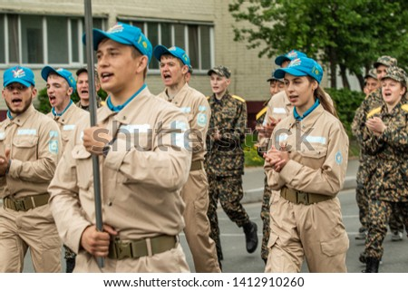 Petropavlovsk, Kazakhstan - June 1, 2019: International Children's Day. The parade of schoolchildren students through the streets of the city. Children and parents in national holiday clothes.  #1412910260
