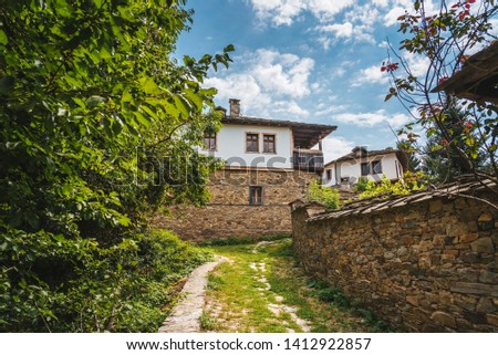 Traditional old Bulgarian house in the countryside.  KOVACHEVITZA VILLAGE, BULGARIA. #1412922857