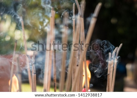Close up of burning incense sticks #1412938817