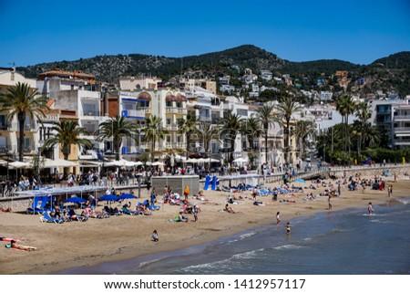 Sitges, Spain-  May 19, 2019: the San Sebastián Beach in Sitges, Catalonia Spain #1412957117