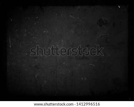 Black grunge scratched background, old film effect, scary dusty texture #1412996516