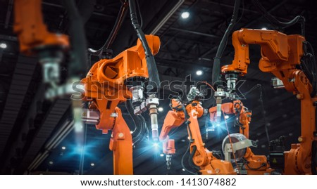 heavy automation robot arm machine in smart factory industrial #1413074882