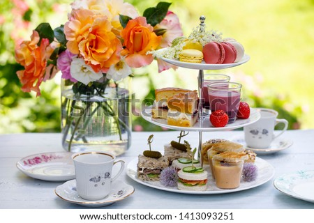 Afternoon tea in the garden Royalty-Free Stock Photo #1413093251