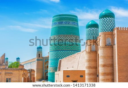 Historic architecture of Itchan Kala, walled inner town of the city of Khiva, Uzbekistan. UNESCO World Heritage Site. Royalty-Free Stock Photo #1413171338