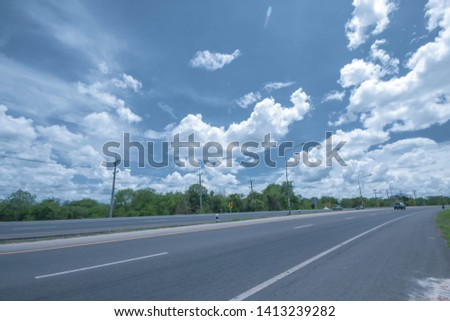 Bright sky during the day light hours, the hot, fluffy, white and feeling free and gray clouds float around the vast sky. A panoramic view beside the road and mountain looking and feeling free.  #1413239282